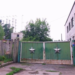 Main gate to former secret military town Chernobyl-2